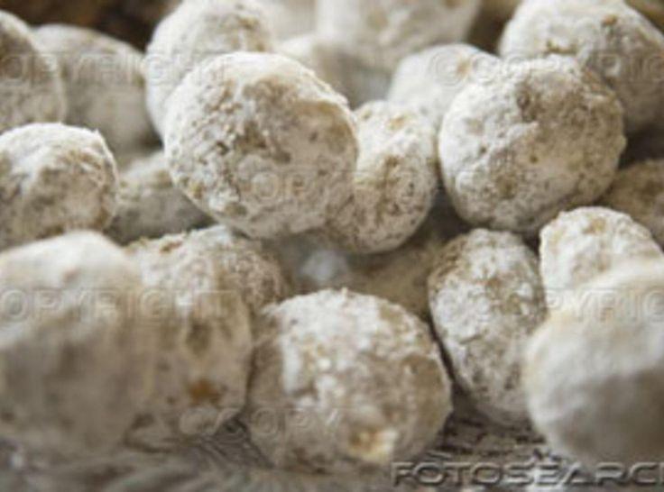 Pferfferneusse German Christmas cookie recipe from 1889! 4 1/2 c brown sugar firmly packed 1 lb raisins ground 1 lb brazil nuts ground, 1 lb walnuts ground, 1/2 lb candied orange and citron peel,  1 1/2 c warm water, 9 eggs well beaten large size, 2 tsp baking soda, 1 1/2 tsp fresh nutmeg ground, 1 tsp ground cloves, 1 Tbsp salt, 4 1/2 lb all purpose flour, 4 tsp baking powder, 2 Tbsp ground cinnamon, 2 Tbsp ground allspice, 1 Tbsp anise seed