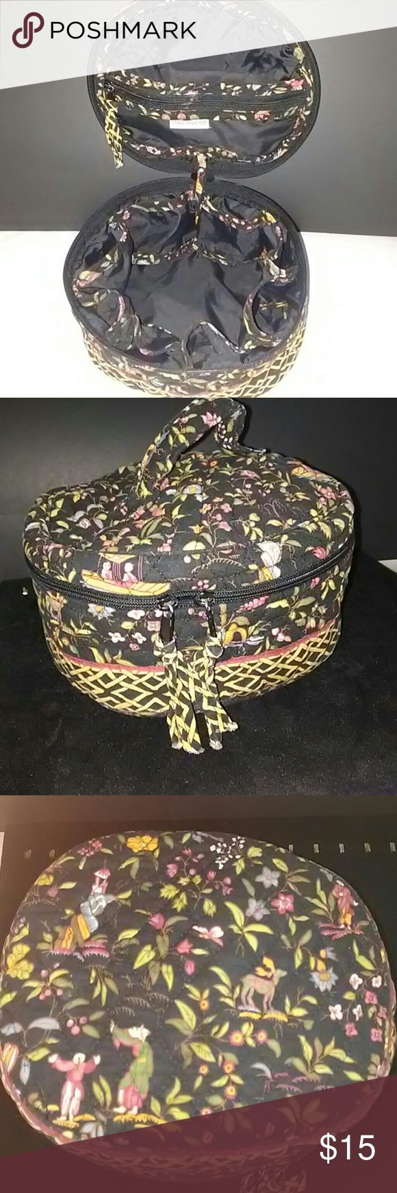 .Used vera Bradley toiletry makeup storage bag Used makeup travel bag 9 inches round from side to side on the top width.long is 3 inches. The bag has a lot of compartments inside to store makeup or your travel needs. The bag is clean there is a small rip on the zipper part near the tag and lining a small rip it can be sewed if you have a talent other than that  I couldn't see any other issues please look at all pictures. And see if this inperfections are ok with you before you purchase this…