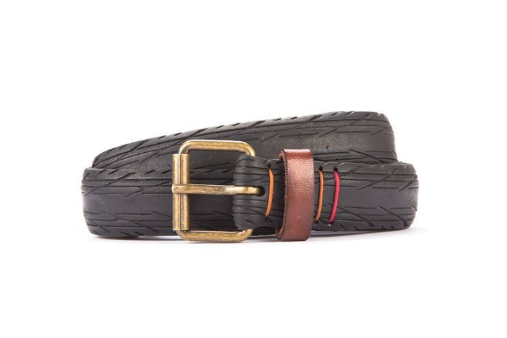 #2665 - Black belt from a spare race bicycle tyre, entirely handcrafted, iron branded and numbered. Brown, leather belt loop. Strap folded up and stitched up with cotton colored strings.