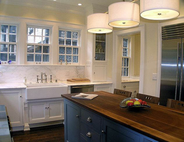 Cream city construction beautiful two tone kitchen for Butter cream colored kitchen cabinets