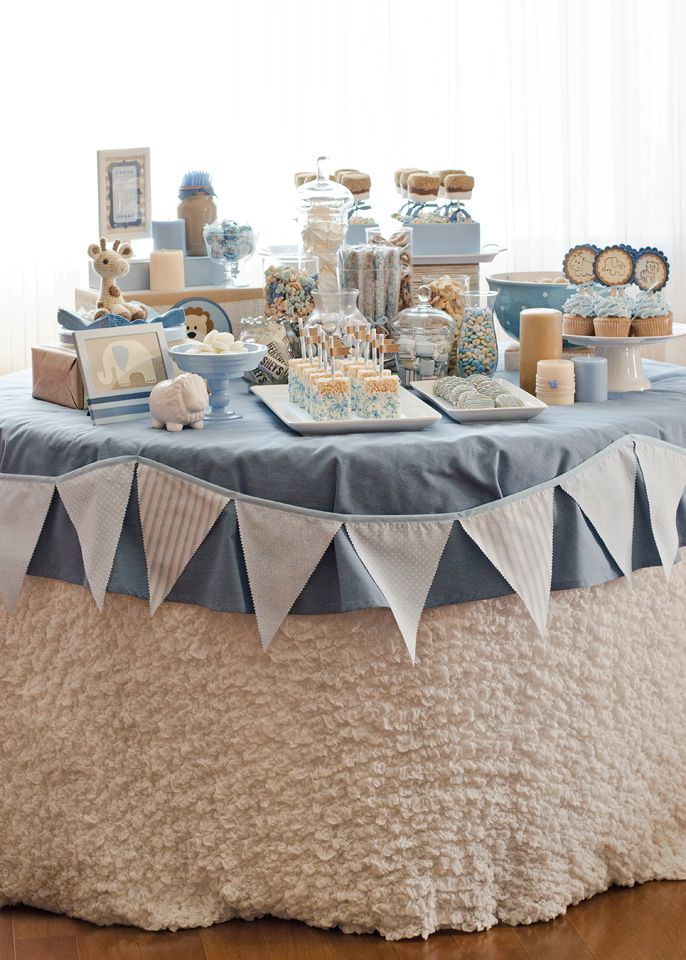 Pretty blue and white dessert table for a baptism or baby shower. The table draping kind of looks like lambswool.