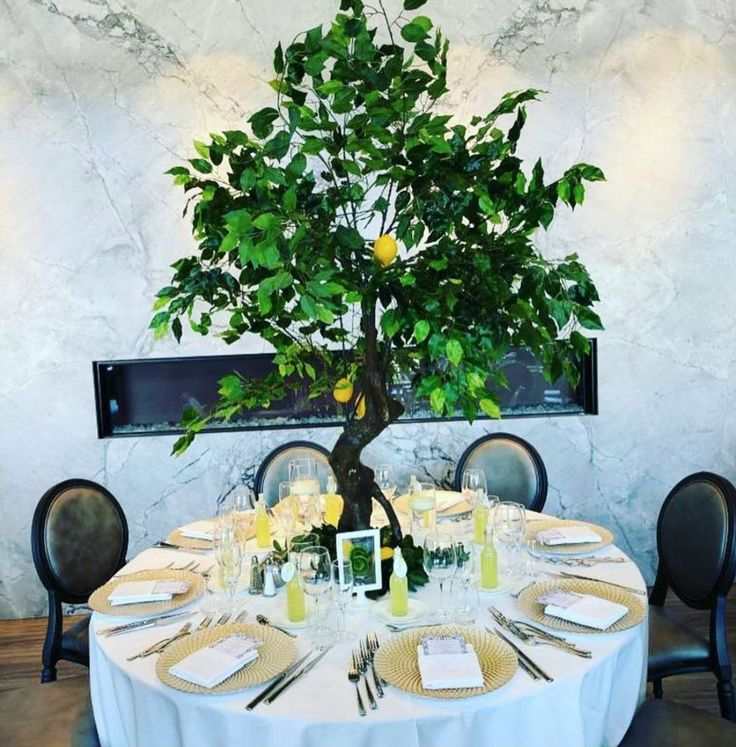 """""""Under the Tuscan Sun"""" event by R5 Event Design! Complete with green trees, lots of greenery, lemons & golden charger plates!"""
