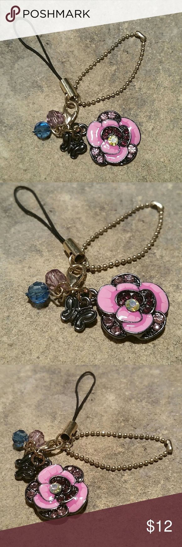 """ANNA SUI Enameled Flower Purse Charm / Keychain New, never used, retired vintage design, Anna Sui enameled flower purse charm or key chain. Pink flower accented by light and dark pink & aurora borealis (rainbow sheen) crystal rhinestones, metal butterfly,  pink and blue crystal beads. Anna Sui stamped on back. Feminine, sophisticated & very stunning for sure, as Anna Sui designs are! Flower .75"""", total 3"""".  Matching jewelry pieces available in my closet!  Thank you for visiting my closet…"""