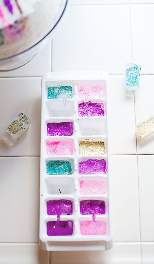 Edible Glitter Ice Cubes tutorial from @asubtlerevelry - These frozen cubes of awesome gave drinks a festive and sparkly vibe. They'll be amazing to use for birthday parties and any holiday!