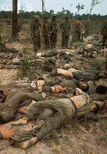 12 Apr 1968, Saigon, Vietnam — 4/12/1968-Saigon, Vietnam- Soldiers of the 25th Infantry Division look at the bodies of more than 50 Viet Cong killed in the Battle of Good Friday 80 miles NW of Saigon 4/12. The Infantry Division was participating in...