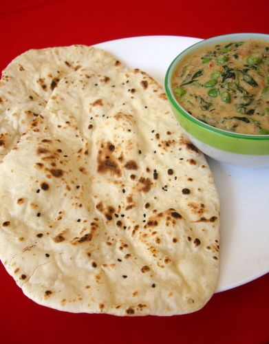 All of us at home relish Naan. Most times we pick up at a take-away but in recent past I have been preparing Naan at home. Its almost close to the Naan prepared the traditional way using the tandoor (clay oven).