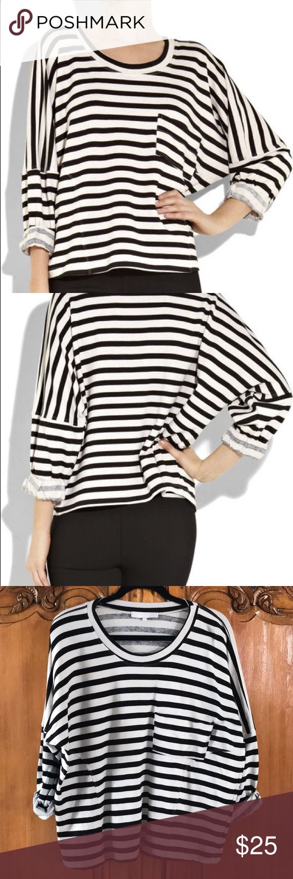 Kain Jersey Stripe Top Kain black and off white jersey top with classic stripe. Wonderful detail with front seaming and breast pocket. Oversized, slight fit, scoop neck and dropped shoulder seams, batwing sleeves and rolled cuffs. Simple slip on Style. Excellent condition. Kain Tops