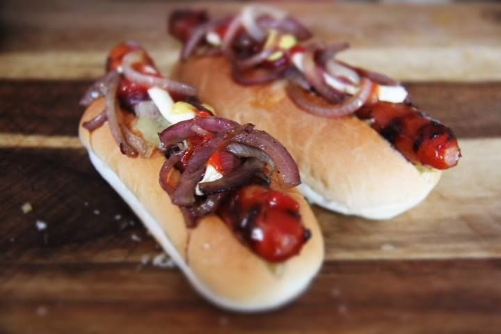 Cransky Hot Dogs with Pickled Cabbage, Glazed Red Onions, Tomato Sauce, Mayo, Mustard & Cheese
