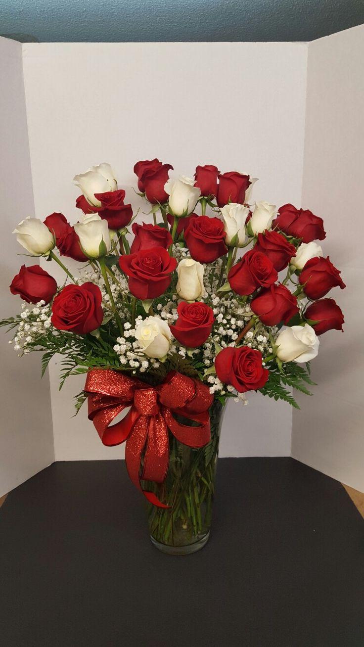 2 dozen red roses and 1 dozen white roses.