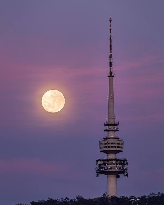 """When is too much supermoon never enough? When you get up at 5am to watch the moon transition behind Telstra Tower."" We love this photo Instagrammer @glenn_photographer captured earlier in the week of the supermoon phenomenon over Canberra. #visitcanberra #onegoodthingafteranother"
