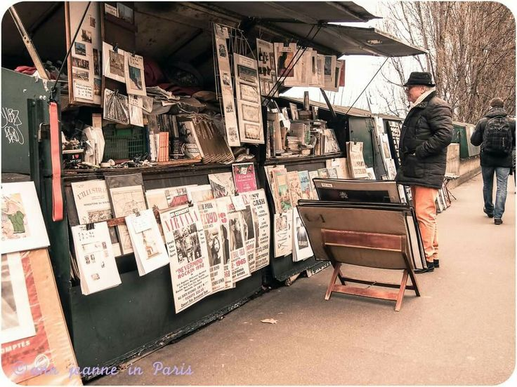 PARIS - A bookstall ( = bouquiniste) in Paris. There are more than 200 bookstalls along the river Seine. They are selling antiques books, second hand books, postcards (old and new), posters, souvenirs too.  A tradition which started during the mid 19th century in Paris  Check out my new article about the 19th century in Paris