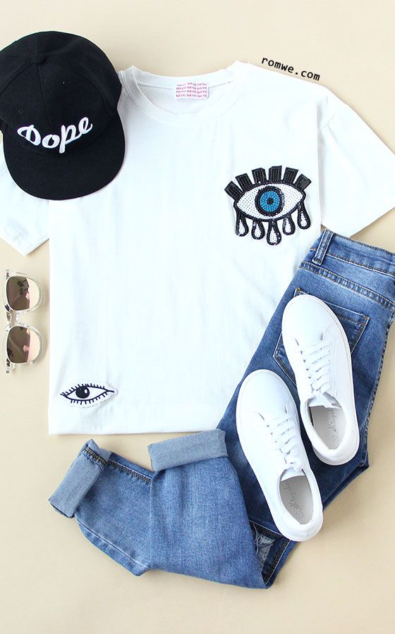 Sequins Eye Pattern White T-shirt with ripped denim jeans and white sneakers - street fashion