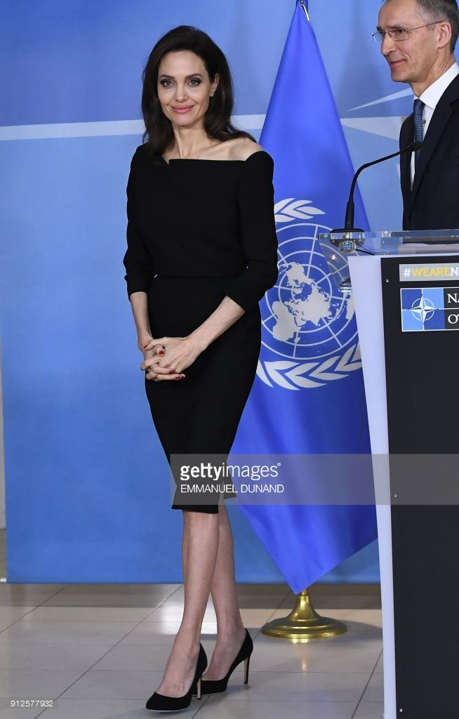 US actress and Special Envoy for the United Nations High Commissioner for Refugees (UNHCR) Angelina Jolie leaves after a press conference following a meeting with NATO Secretary General Jens Stoltenberg in Brussels on January 31, 2018.    / AFP PHOTO / Emmanuel DUNAND        (Photo credit should read EMMANUEL DUNAND/AFP/Getty Images)