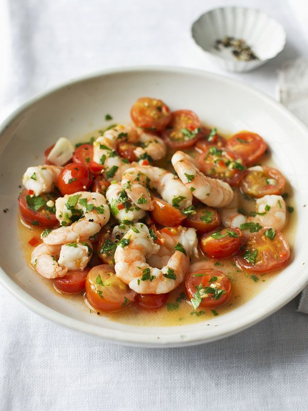 Prawns with chilli and tomato make a beautiful side dish or light main course. Five minutes and it's on the table.