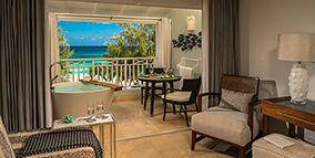 Barbados Accommodations – Rooms and Suites at Sandals Barbados All-Inclusive Resort Beachfront Penthouse Club Level Suite with Balcony Tranquility Soaking Tub - OPT