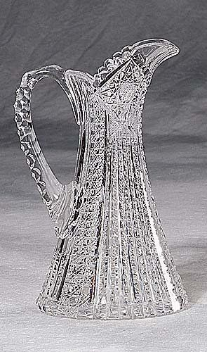 Cut-glass pitcher scalloped spout over flared body