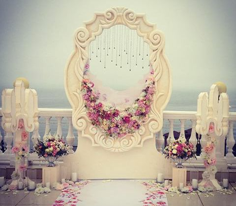 Got a handyman in your life? Cut out and paint a backdrop of a unique design. Highlight some of the edges with florals...