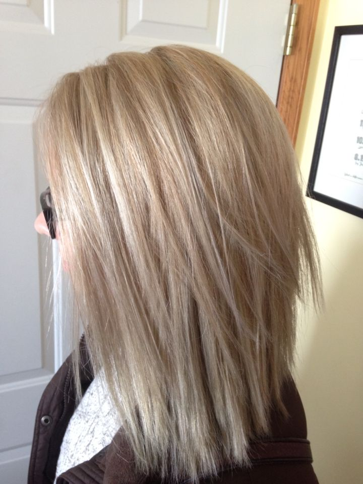 Beautiful Ash Blonde Color Correction. Bleach foils/SoColor 7A-roots 30 mins, ends 10 mins (10 vol) /Toned at bowl with Wella Color Charms 8A-9A equal parts with 10vol.