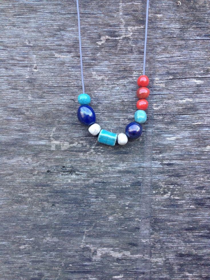 collana di perle in ceramica raku, asimmetrica, multicolor, rosso turchese blu bianco di LaterraCrea su Etsy