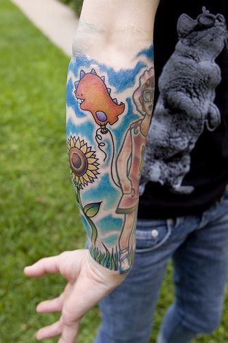 Pretty forearm sleeve tattoo.  fuckyeahtattoos:    via