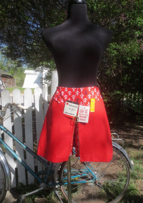 THIS DEAD STOCK 1960S 100% COTTON CHERRY RED BICYCLE SKIRT/SKORT IS A STUNNER! THIS WONDERFUL VINTAGE PIECE WAS FROM A LINE CALLED FABRIMATES BY STEVCOKNIT. IT STILL HAS ITS ORIGINAL TAGS AND IS IN PRISTINE VINTAGE CONDITION. THE SKIRT HAS A RINGED BRASS ZIPPER DOWN THE FRONT WHICH