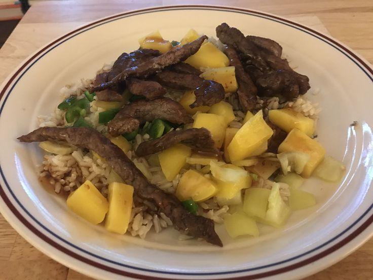 Orange steak strips rice with mango's and Orange sause