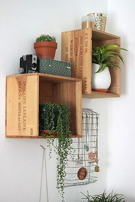 Repurposed wine crates create unique wall shelving units for plants or cookbooks.