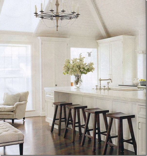 An all white kitchen that is not too utilitarian.  Nice island.  Designer is Mick de Giulio and he describes the kitchen as a mix -- it feels a little New England and a bit beach house with some Scandinavian thrown in.  The only theme was fresh and crisp and clean.  (House Beautiful).