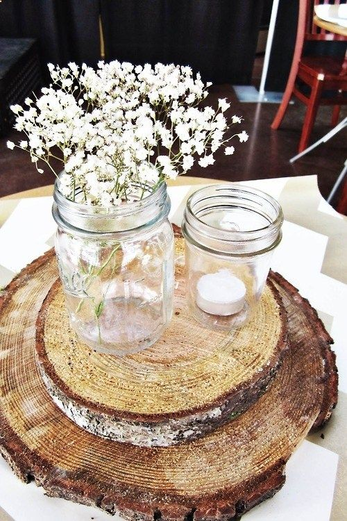 Wooden centerpieces, mason jars and babys breath for baby shower. Would be cute to wrap jars with burlap bow with a touch of blue or pink added in.