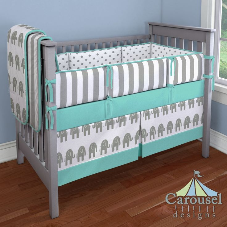 Crib bedding in White and Gray Polka Dot, White and Gray Stripe, Solid Teal, White and Gray Elephants. Created using the Nursery Designer® by Carousel Designs where you mix and match from hundreds of fabrics to create your own unique baby bedding. #carouseldesigns