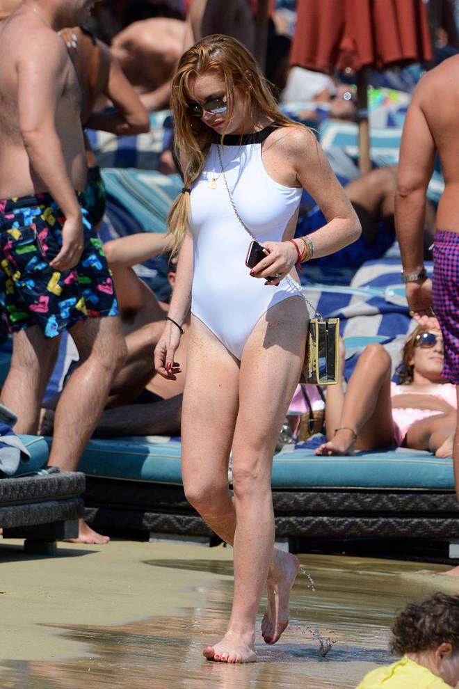 Beach babe #LindsayLohan wearing our #cleopatra #onepiece in #nammosmykonos!  #beachflirt #beachflirt22 #mykonos #madeingreece #hollywood #bikini #bikinis #amazing #white #models #beachclub #beach #actress