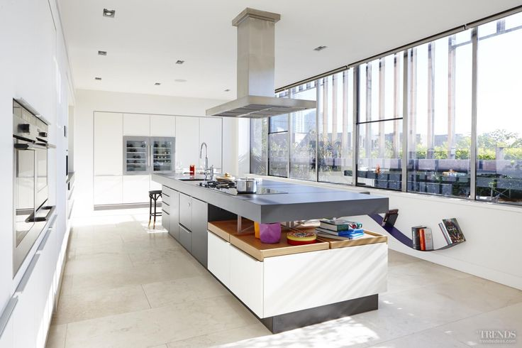 New apartment kitchen by Poggenpohl teams +MODO grey and white lacquer with timber elements on long island with a cantilevered end and +Integration perimeter cabinetry #Poggenpohl #kitchen