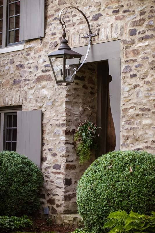 Recessed door with a gorgeous hanging lantern outside | love the wall colour against the warm colour of the window shutters