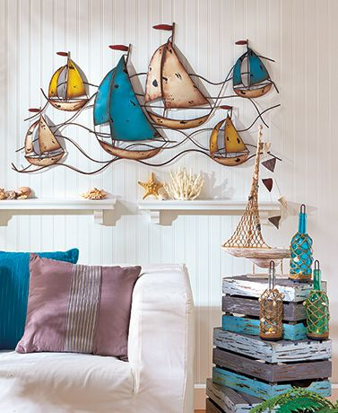 """Bring a breath of ocean air to your home with this Coastal Home Decor Collection. Create a focal point with the oversized Sailboat Metal Wall Sculpture (45""""W x"""