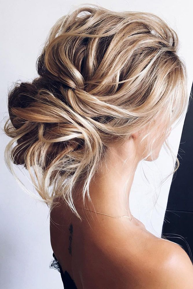 wedding updos curly messy low bun on medium blonde…