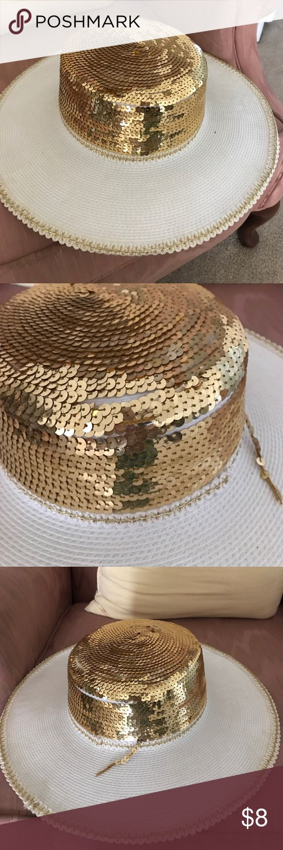 White and gold hat. White hate with gold sequins. In good condition. Had been worn. Some makeup is visible on the inside but none on outside. Very good condition! Accessories Hats