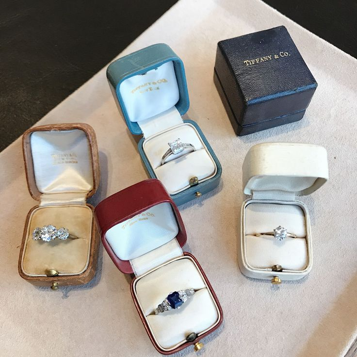 Vintage Tiffany & Co. engagement rings in vintage Tiffany ring boxes.