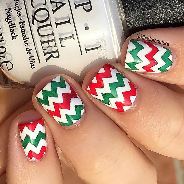 Red, White, and Green Christmas Nail Art. This was created using @bundlemonster plate BM-423 and carefully painting alternating parts of the chevron stamp with @konad_art Red and @opi_products Christmas Gone Plaid.m (green). Base is OPI Alpine Snow!