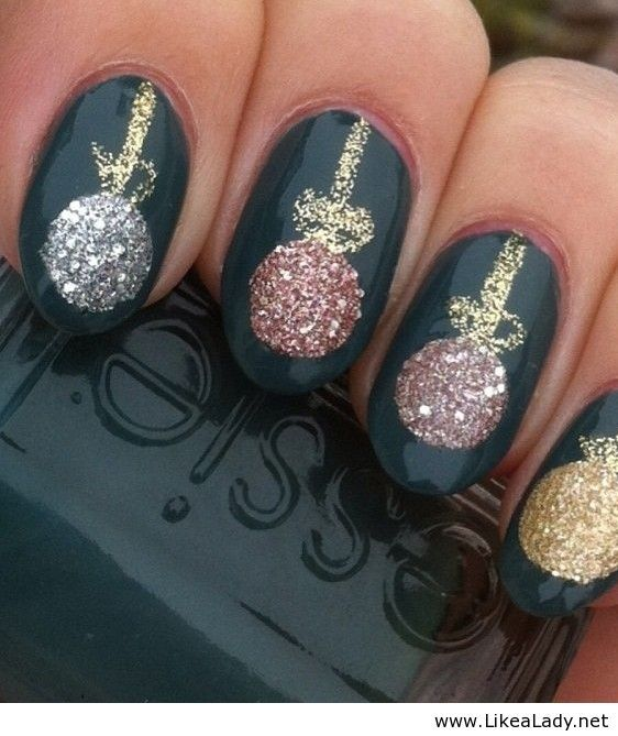 Christmas nail art with glittering festive baubles over a bang on trend green varnish background...x