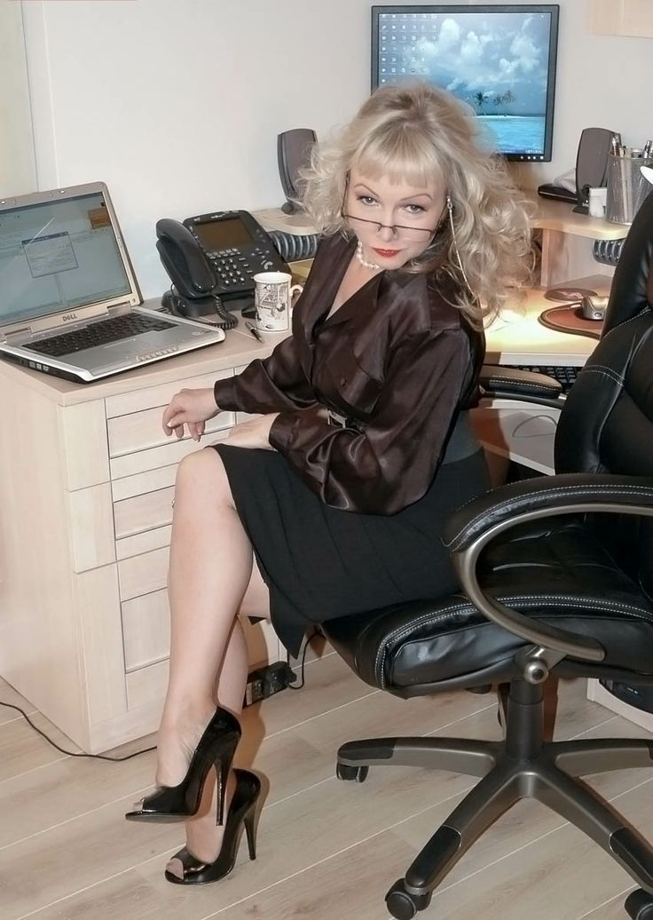 Mature ladies in office suits this