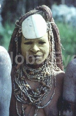 Chimbu woman in mourning. Highlands, Papua New Guinea. Stock Photo By Rob Walls