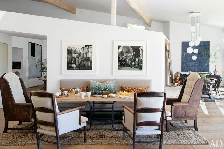 Fashion photographs by Melvin Sokolsky are displayed in a dining area in Patrick Dempsey's Malibu home.