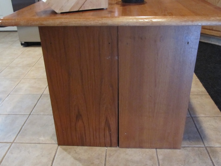 Two cabinets back to back and a top.  This was two bookcases or end tables and a square top from a coffee table.  Sew Many Ways...: Colleen's Corner...Make A Quick Kitchen Island