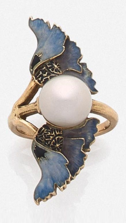 LALIQUE - An Art Nouveau gold, enamel and pearl ring, circa 1900. Set to the centre with a bouton pearl, flanked by blue enamelled poppy flowers. Signed. #Lalique #ArtNouveau