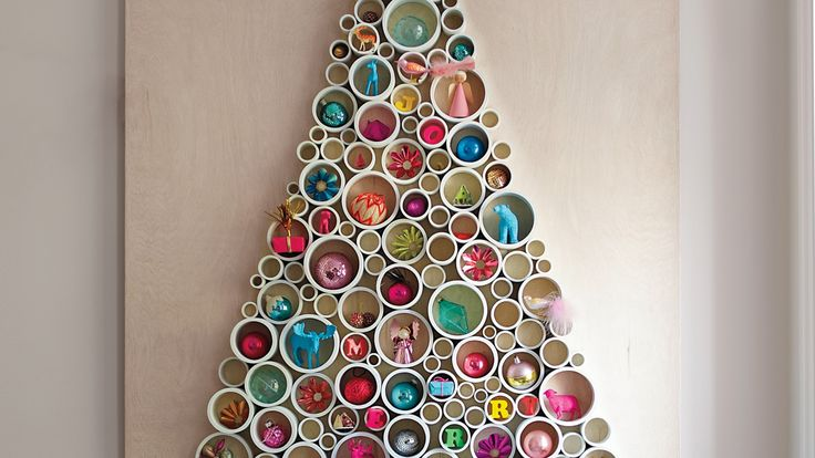 Eclectic MixEvery little thing you love -- from teensy toys to mismatched collections of vintage holiday items -- has a home on this tree. Start by choosing a palette (we picked bright, happy colors), then fill pipes accordingly: We spray-painted plastic toy animals, spelled out joy and merry with letter magnets, and interspersed tiny wrapped presents, Advent calendar-style. Play around with the placement until you like the overall look (avoid grouping similar objects).Small-Space…