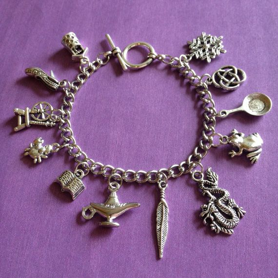 This silver charm bracelet represents all 12 Disney Princesses! It has a wishing…