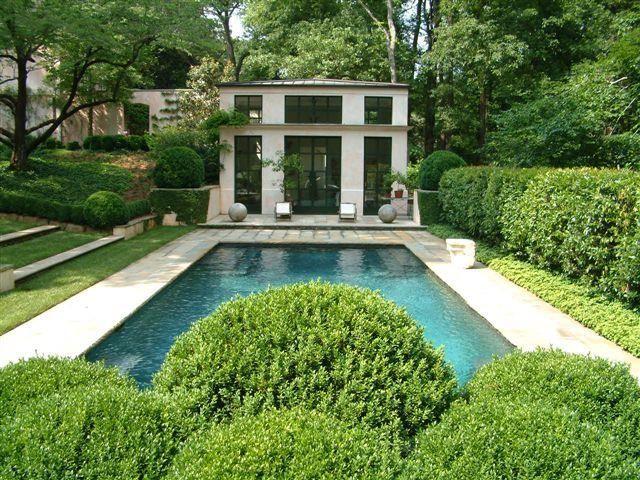 Boxwoods & Pool in a garden by Howard Design Studio