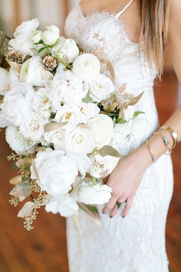 oversized white bouquet - photo by Amanda Jameson Weddings http://ruffledblog.com/modern-wedding-inspiration-with-grey-and-gold Metallic bridal bouquet Gold bridal bouquet