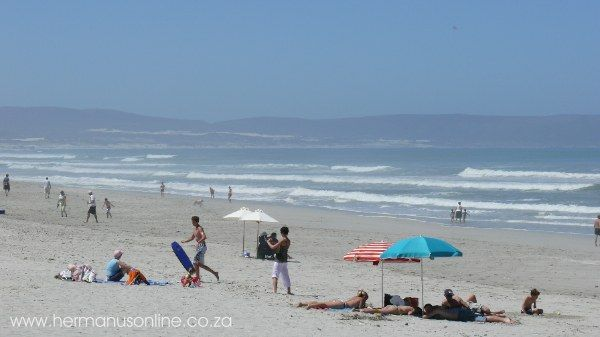 Visit GROTTO BEACH - HERMANUS The Blue Flag Grotto Beach is one of the most striking South African beaches with its rolling waves and mountainous backdrop