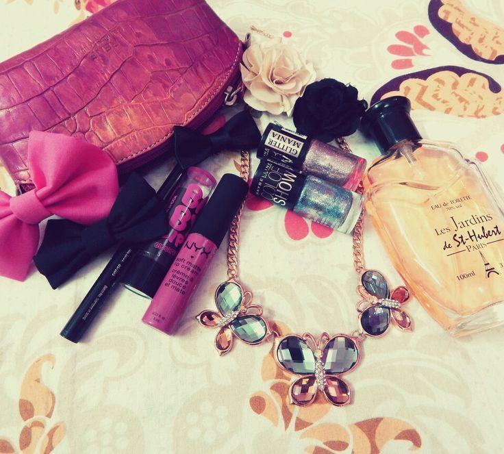 Lipstick accessories purse perfume nailpolish necklace